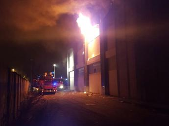 Migrants protest deadly blaze at disused factory