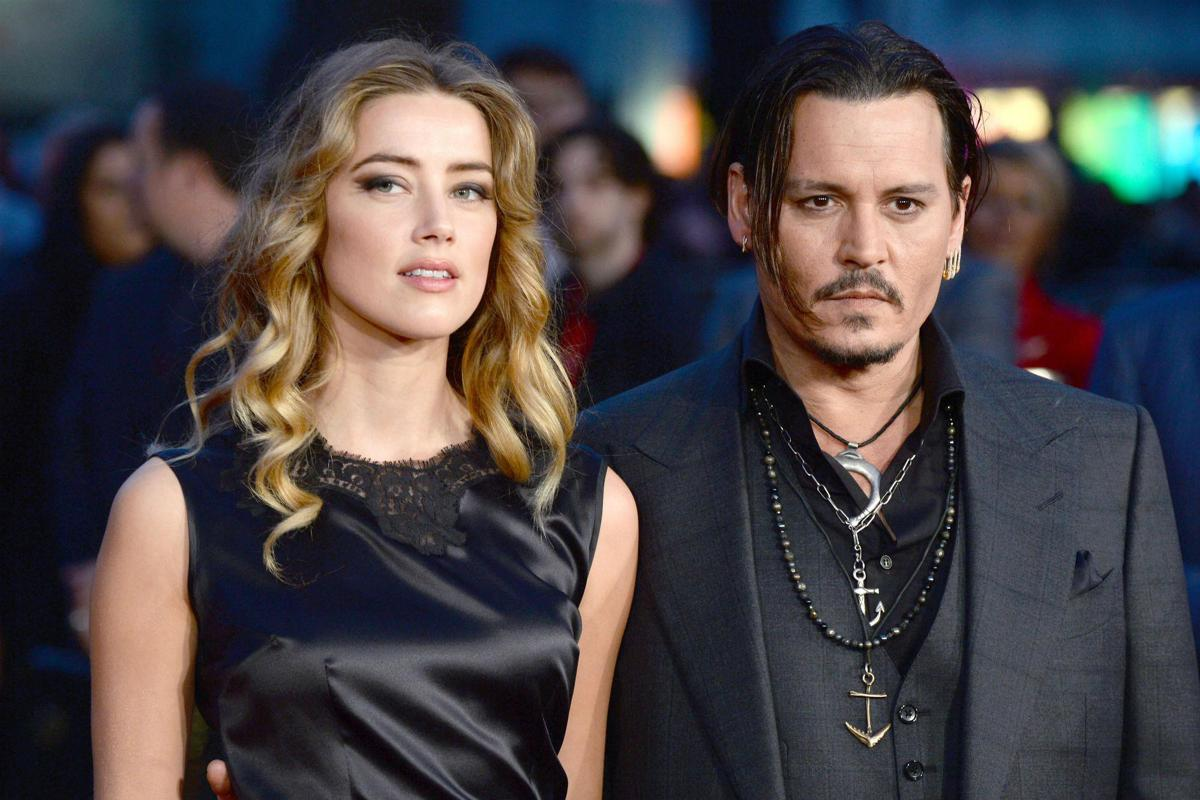 Johnny Depp fa causa ad Amber Heard